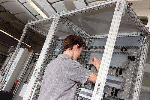 Telecommunications enclosure assembling